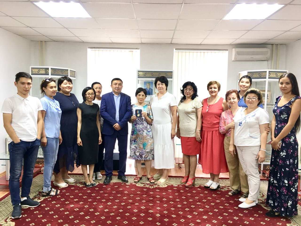 """On 18 of July 2018 the archivists of the Division Coordination of Working departmental archives and paperwork, publication and using documents Alshynbayeva M. and Mukanova G. were conducted an excursion for the staff of the State Archive of Astana entitled """"Astana: past and future"""", devoted to 20th anniversary of capital."""